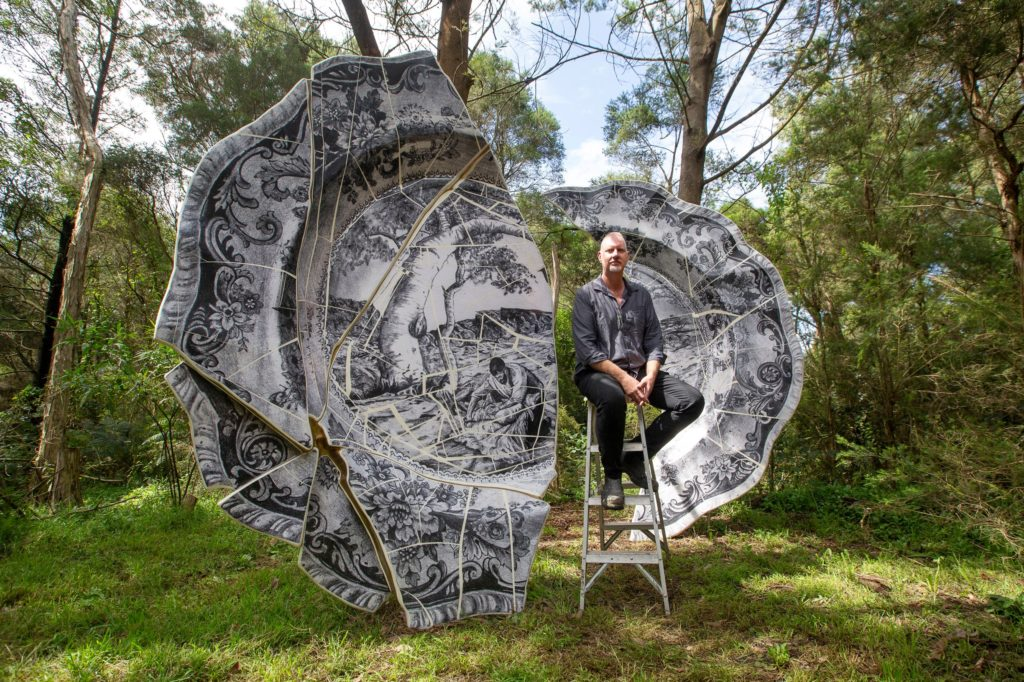 Artist with Sculpture of Plate
